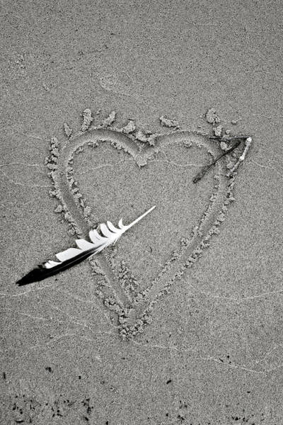 Photograph - Feather Arrow Through Heart In The Sand by Peter Pauer
