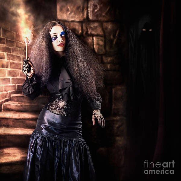 Black Magic Woman Wall Art - Photograph - Female Jester Walking Inside Dark Castle Stairwell by Jorgo Photography - Wall Art Gallery