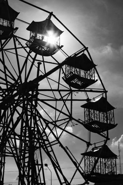 Photograph - Ferris Wheel Sun by Lee Webb
