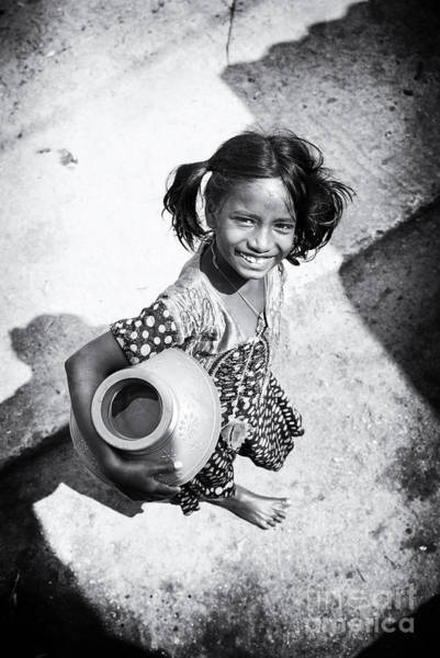 Thirst Photograph - Fetching The Water by Tim Gainey