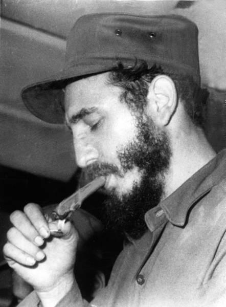 Cigar Photograph - Fidel Castro, Lighting A Cigar, 1967 by Everett