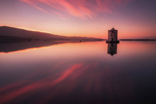 Photograph - Fiery Mirror - The Windmill In Orbetello Reflecting Itself In The Mirror Like Water by Matteo Viviani