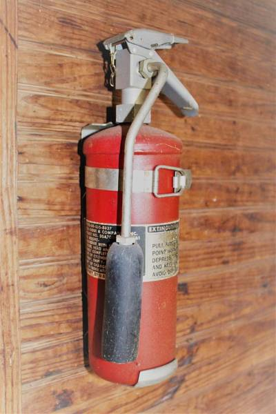Wall Art - Photograph - Fire Extinguisher by Heather Ann