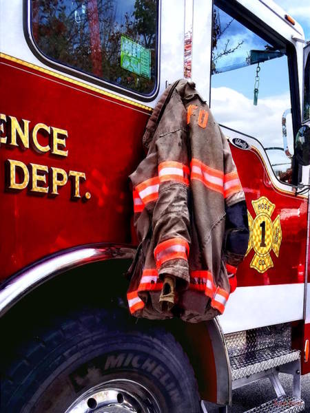 Photograph - Fireman's Jacket On Fire Truck by Susan Savad