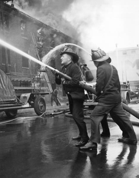 Crisis Photograph - Firemen With Hose by Underwood Archives