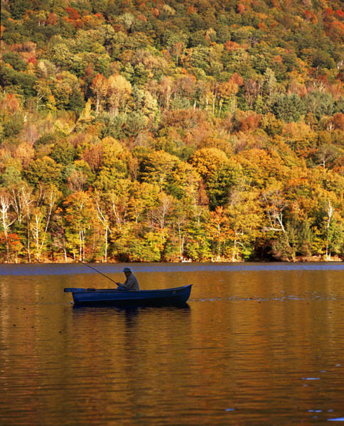 Wall Art - Photograph - Fisherman In Boat With Fall Foliage by Gillham Studios