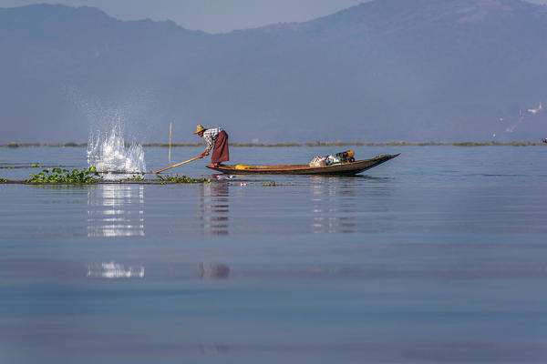 Photograph - Fisherman On His Boat Catching Fish by Pradeep Raja PRINTS