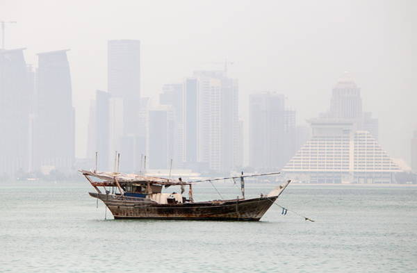 Photograph - Fishing Dhow And Misty Towers by Paul Cowan