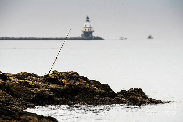 Photograph - Fishing Rod On Rocks by Michael D Miller