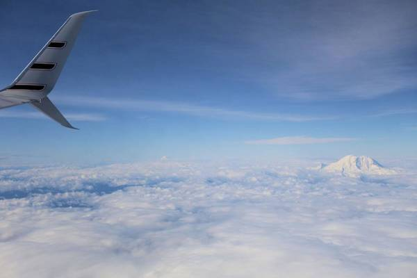 Photograph - Fly Over Washington And Mount Rainier by Dan Sproul