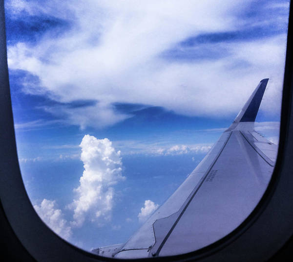 Photograph - Flying Above The Clouds by Atullya N Srivastava