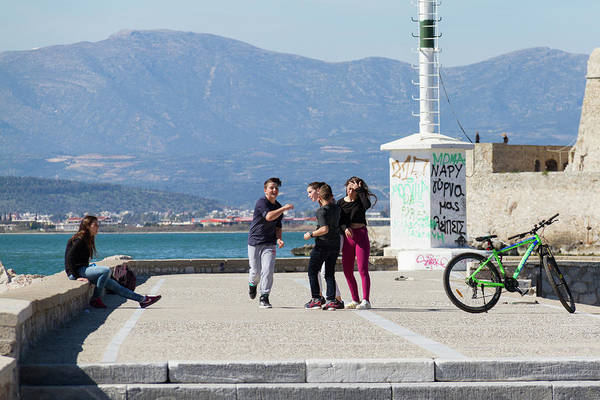 Wall Art - Photograph - Fooling Around At The Seafront by Iordanis Pallikaras