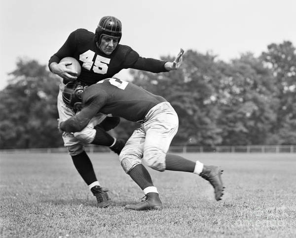 Photograph - Football Player Being Tackled, C.1940s by H. Armstrong Roberts/ClassicStock