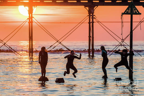 Four Girls Jumping Into The Sea At Sunset Art Print