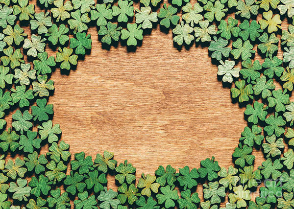 Four Leaf Clover Photograph - Four-leaf Clovers Laying On Wooden Floor by Michal Bednarek