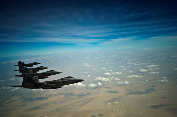 Laser Gun Photograph - Four Lockheed Martin F-22 Raptors On Patrol In Enemy Airspace by L Brown