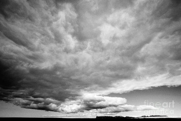 Wall Art - Photograph - frontal cloud formation over vast volcanic ash flats Iceland by Joe Fox