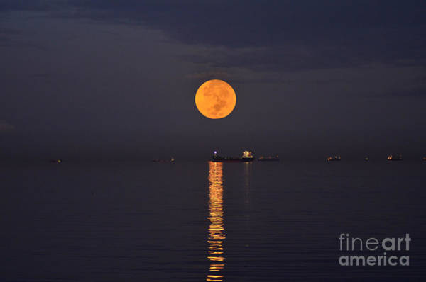 Photograph - Full Moon With Orange Glow Upon The Sea by Christopher Shellhammer
