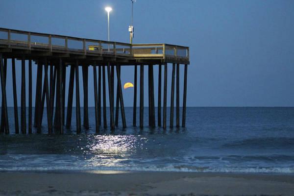 Photograph - Full Worm Moon Thru The Pier by Robert Banach