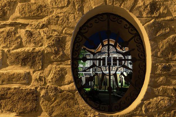 Photograph - Illuminated Night View - Beautiful Revival House Through A Fence Window by Georgia Mizuleva