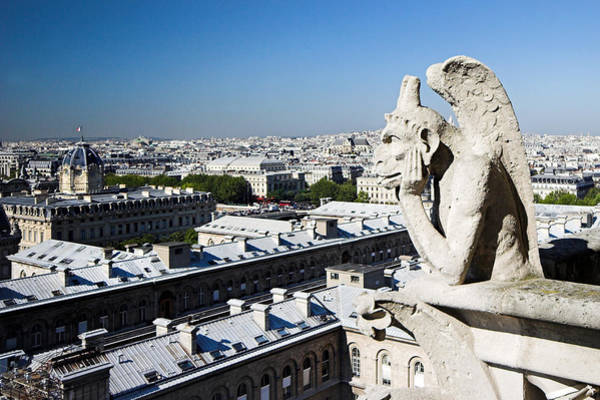 Photograph - Gargoyle Guarding The Notre Dame Basilica In Paris by Pierre Leclerc Photography