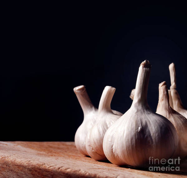Wall Art - Photograph - Garlic Bulbs On Wooden Table by Jelena Jovanovic