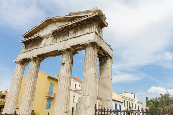 Wall Art - Photograph - Gate Of Athena Archegetis And Church In The Background In Roman Agora by Iordanis Pallikaras