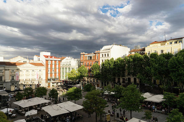 Photograph - Gathering Clouds Do Not Stop The Gathering Crowds - Plaza Santa Ana Madrid Spain by Georgia Mizuleva