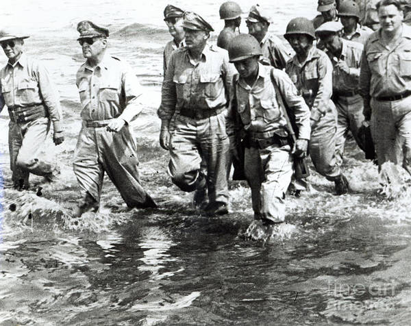 Philippines Photograph - General Douglas Macarthur Wades Ashore At Leyte On His Return To The Philippines by American School