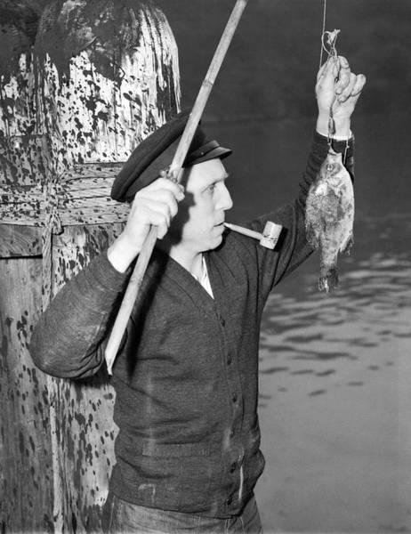 Fishing Tackle Photograph - German Crewman Fishes In Sf by Underwood Archives