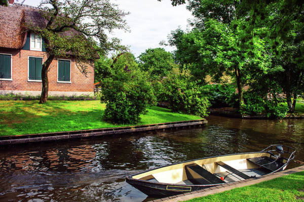 Wall Art - Photograph - Giethoorn Scene With Boat And Cottage. The Netherlands by Jenny Rainbow