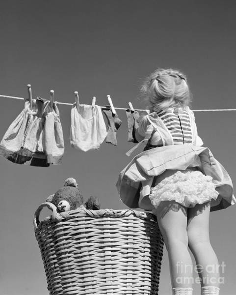 Wall Art - Photograph - Girl Hanging Laundry, C.1950s by D. Corson/ClassicStock