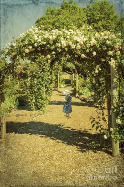 Photograph - Girl In A Rose Garden by Elaine Teague