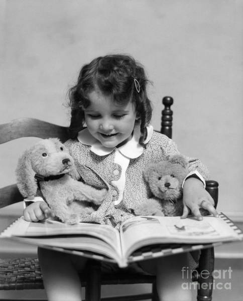 Wall Art - Photograph - Girl Reading Storybook, C.1930s by H. Armstrong Roberts/ClassicStock
