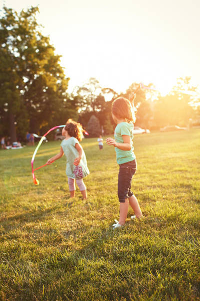 Wall Art - Photograph - Girls Playing Together On Evening Lawn by Gillham Studios