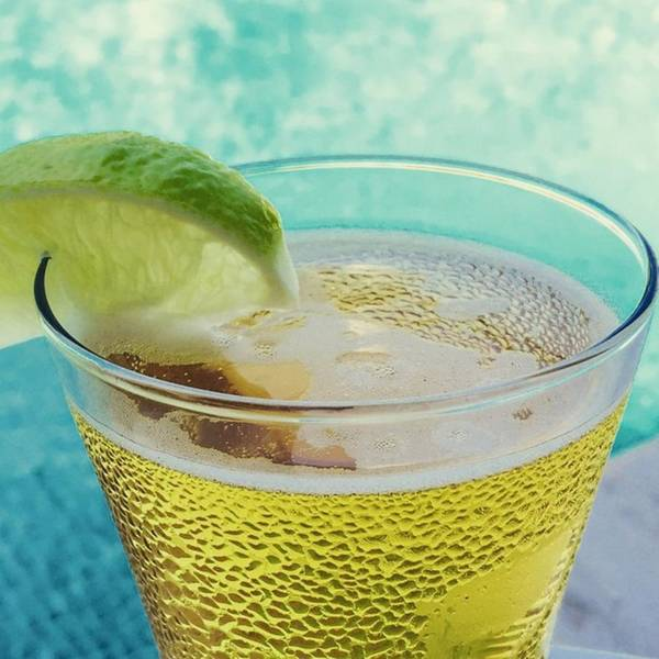 Beer Wall Art - Photograph - Glass Of Beber With Lime By A Pool by Juan Silva