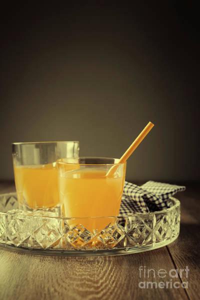Wall Art - Photograph - Glasses Of Orange Juice by Amanda Elwell