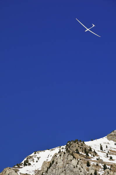 Wall Art - Photograph - Glider Flying Over Snowy Mountain by Sami Sarkis