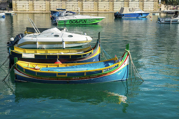 Photograph - Glossy Mediterranean Colors - Traditional Maltese Luzzus And Modern Boats Juxtaposition by Georgia Mizuleva