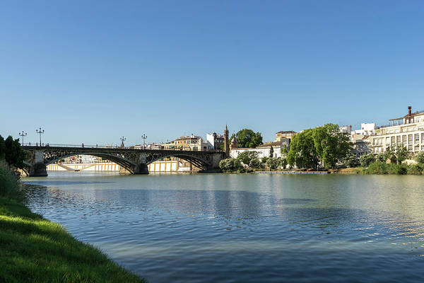 Photograph - Glossy Shadows - Seville Guadalquivir River And Triana Bridge by Georgia Mizuleva