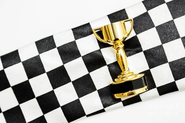 Thoroughbred Racing Wall Art - Photograph - Gold Trophy On A Checked Sport Flag by Jorgo Photography - Wall Art Gallery