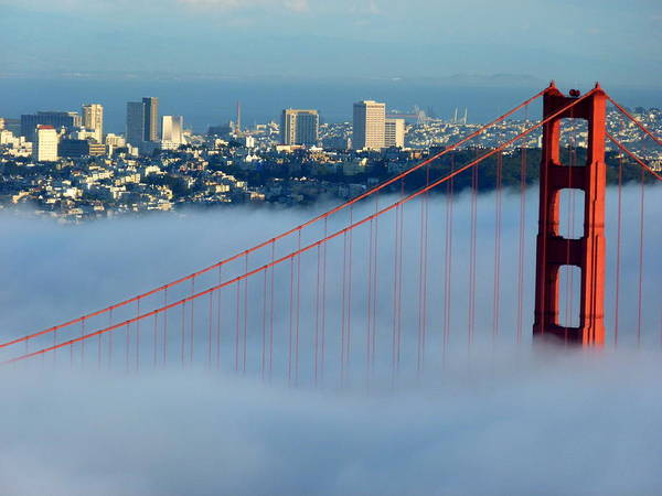 Photograph - Golden Gate Bridge Tower In Sunshine And Fog by Jeff Lowe