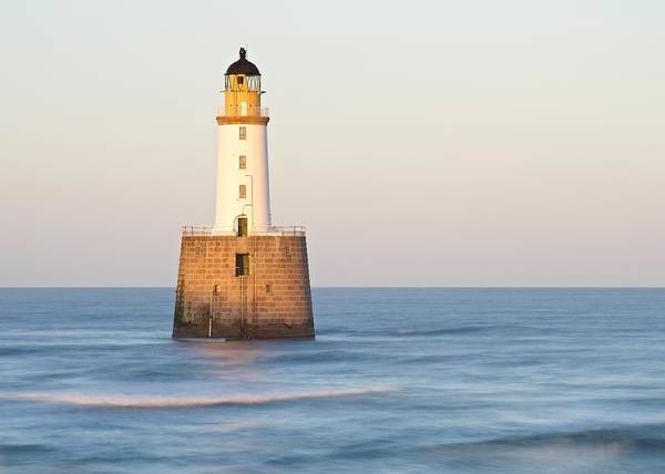 Photograph - Golden Light And Sea Waves At Rattray Head Lighthouse by Stephen Taylor