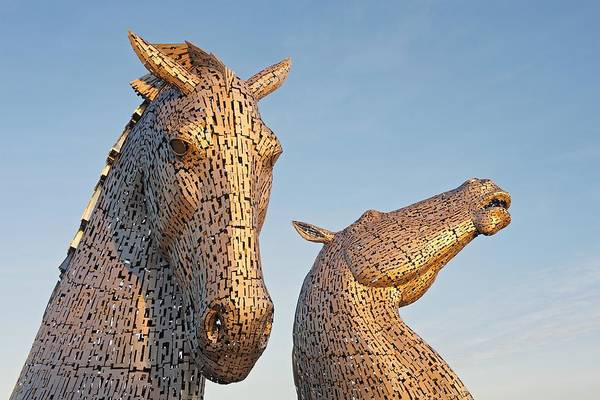 Photograph - Golden Light Hits The Kelpies by Stephen Taylor