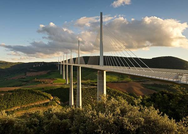 Photograph - Golden Light Hits The Millau Viaduct by Stephen Taylor