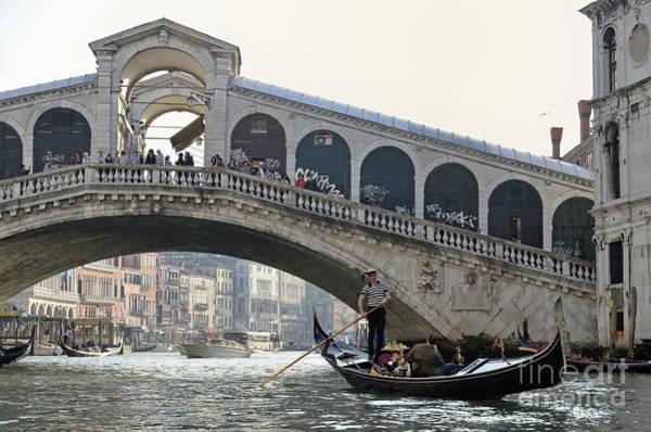Wall Art - Photograph - Gondola Passing By The Rialto Bridge by Sami Sarkis