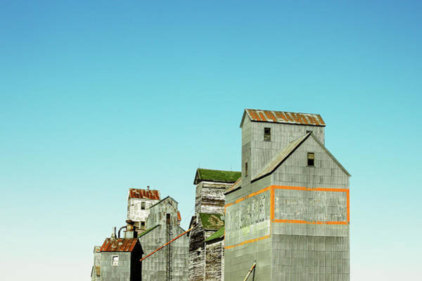 Photograph - Grain Elevator Row by Todd Klassy