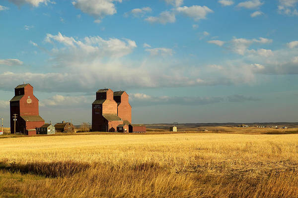 Abandonment Photograph - Grain Elevators Stand In A Prairie by Pete Ryan