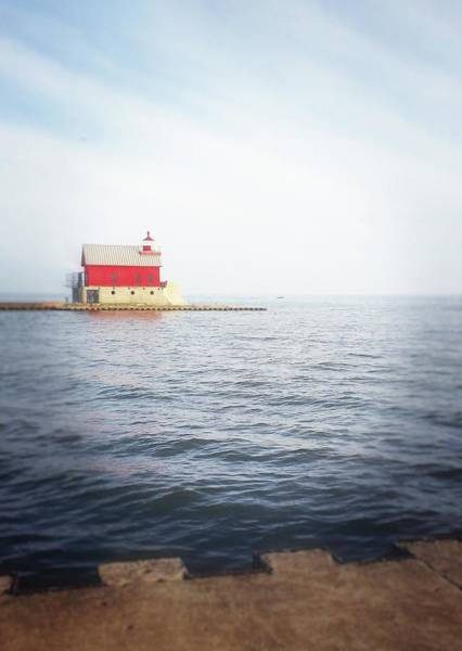 Photograph - Grand Haven Lighthouse From North Pier by Michelle Calkins