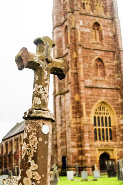 Photograph - Grave Cross With Blurred Church In Background B by Jacek Wojnarowski